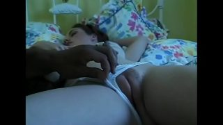 Daddy's friend takes a look to his young daughter while she's sleeping